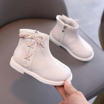 Παιδικές μπότες από οικολογικό δέρμα με σταυρωτούς δεσμούς