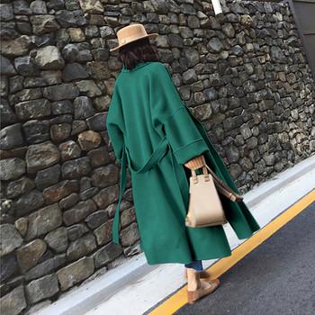 Модерно дамско палто широк модел с джобове и колан