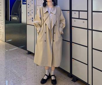 Дълго и широко палто с двуредно закопчаване