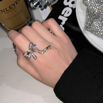 Дамски актуален пръстен с панделка и камъни