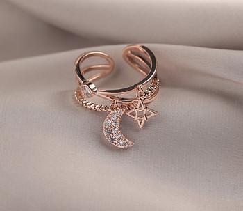 Модерен дамски пръстен с различни елементи и камъни