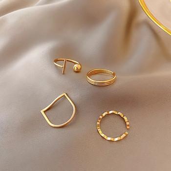 Комплект от четири дамски пръстена изчистен модел