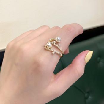 Стилен дамски пръстен широк модел с камъни и перли