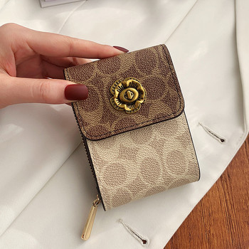 Καθημερινό γυναικείο πορτοφόλι με μεταλλική στερέωση