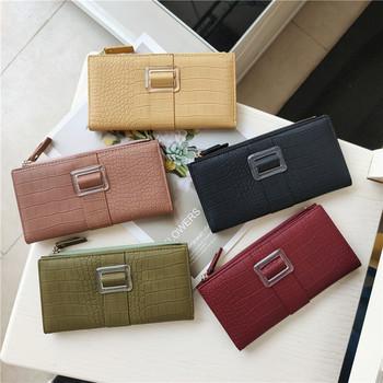 Γυναικείο casual πορτοφόλι από οικολογικό δέρμα με αγκράφα και φερμουάρ