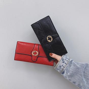 Γυναικείο πορτοφόλι από οικολογικό δέρμα με μεταλλική διακόσμηση σε διάφορα χρώματα