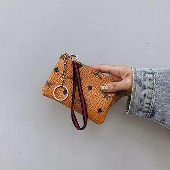 Γυναικείο έκο δερμάτινο πορτοφόλι με μενταγιόν