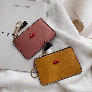 Μοντέρνο γυναικείο πορτοφόλι με τρισδιάστατο στοιχείο και φερμουάρ