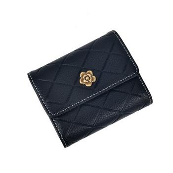 Γυναικείο πορτοφόλι από οικολογικό δέρμα με μεταλλικό λουλούδι