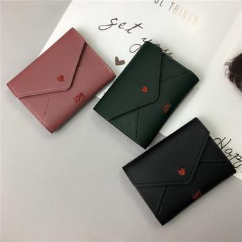 Μοντέρνο μικρό πορτοφόλι από οικολογικό δέρμα με κέντημα