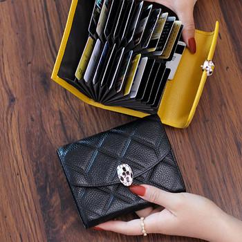 Γυναικείο έκο δερμάτινο πορτοφόλι με μεταλλική διακόσμηση σε διάφορα χρώματα