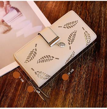Γυναικείο έκο δερμάτινο πορτοφόλι με μεταλλικό κούμπωμα και τσέπη με κέρματα