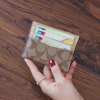Γυναικείο casual πορτοφόλι με τσέπες σε μπεζ και μαύρο