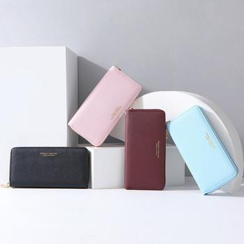Κομψό γυναικείο πορτοφόλι με φερμουάρ και αφαιρούμενη λαβή