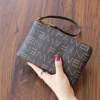 Γυναικείο έκο δερμάτινο πορτοφόλι με φερμουάρ και δερμάτινη λαβή