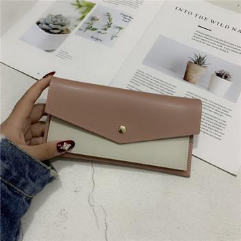 Κομψό γυναικείο πορτοφόλι με μεταλλική στερέωση
