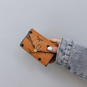 Νέο μοντνέλο γυναικείο έκο δερμάτινο πορτοφόλι με κούμπωμα