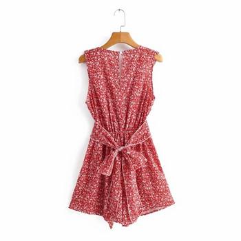 Κοντή καλοκαιρινή ολόσωμη φόρμα με βαθύ ντεκολτέ και βολάν