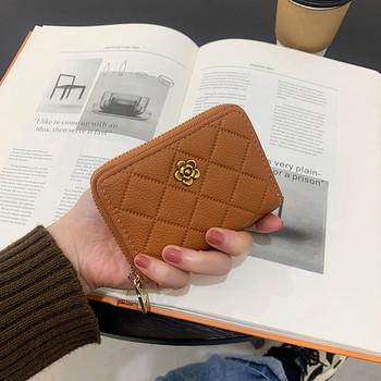Νέο μοντέλο γυναικείο έκο δερμάτινο πορτοφόλι με μεταλλικό στοιχείο και φερμουάρ