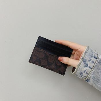 Γυναικείο έκο δερμάτινο πορτοφόλι σε μαύρο και μπεζ χρώμα