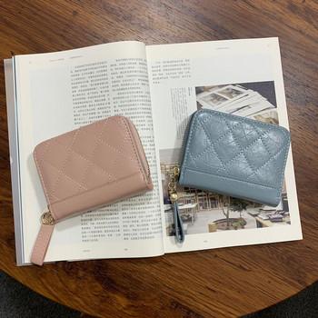 Νέο μοντέλο γυναικείο δερμάτινο πορτοφόλι με φερμουάρ και μεταλλική στερέωση