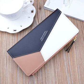 Μοντέρνο πορτοφόλι από οικολογικό δέρμα με μεταλλική στερέωση και φερμουάρ