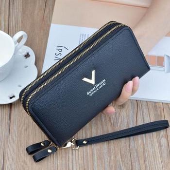 Νέο μοντέλο γυναικείο πορτοφόλι από έκο δέρμα με μεταλλικό στοιχείο
