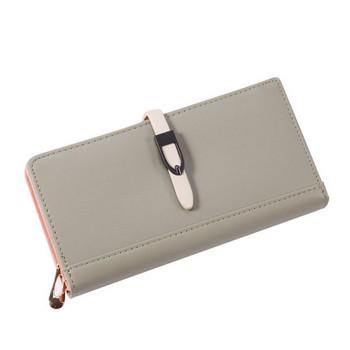 Γυναικείο πορτοφόλι μονόχρωμο  με μεταλλική στερέωση και φερμουάρ