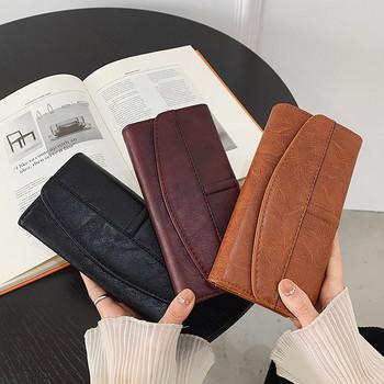 Γυναικείο μακρύ δερμάτινο πορτοφόλι με μεταλλική στερέωση