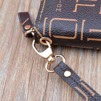 Πολυλειτουργικό πορτοφόλι με διπλό φερμουάρ και μεταλλική επιγραφή