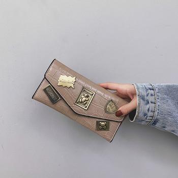 Γυναικείο πορτοφόλι από οικολογικό δερμάτινο και μεταλλικές διακοσμήσεις