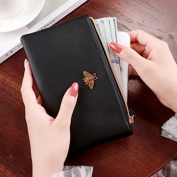Γυναικείο πορτοφόλι απλό μοντέλο από οικολογικό δέρμα με μεταλλική διακόσμηση