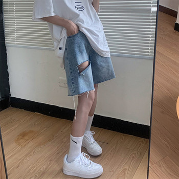 Дамски панталони 3/4 дължина със скъсани мотиви