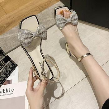 Стилни дамски сандали с панделка