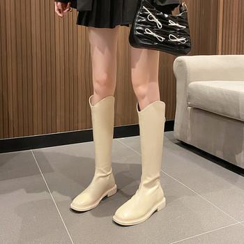 Дамски кожени ботуши с равна  подметка